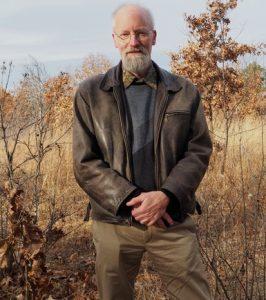 Don Waller standing in a savannah